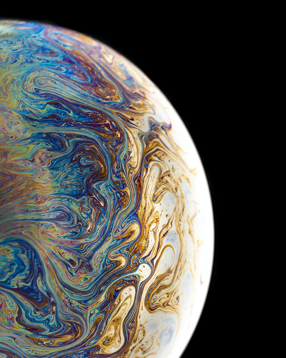 blue, yellow, and brown planet with black background