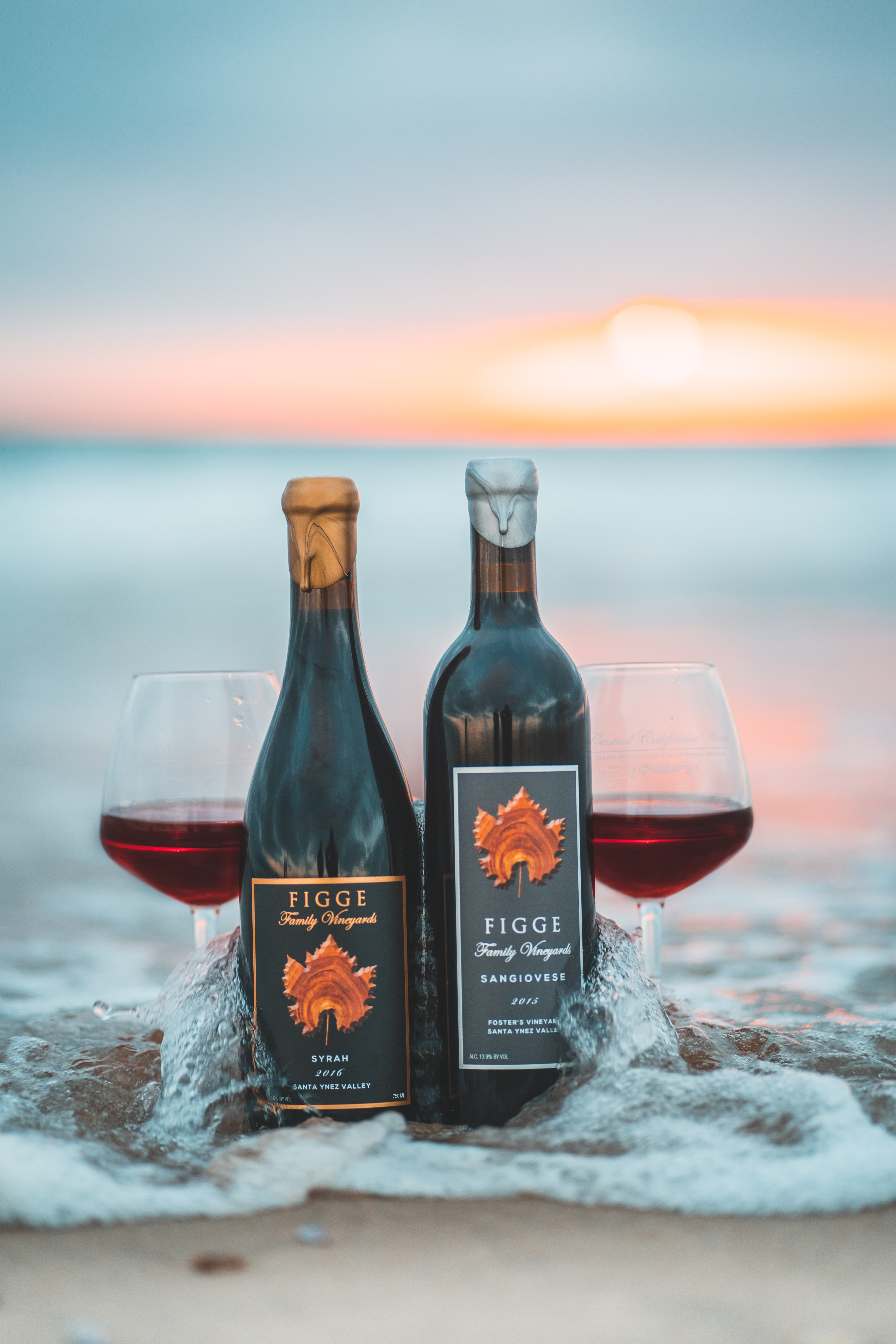 two Figge wine bottles on beach