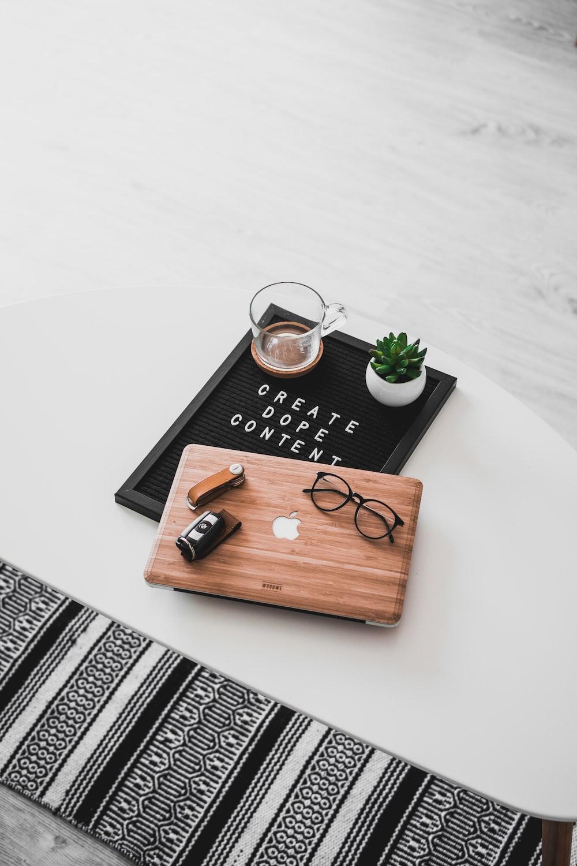 eyeglasses on brown MacBook