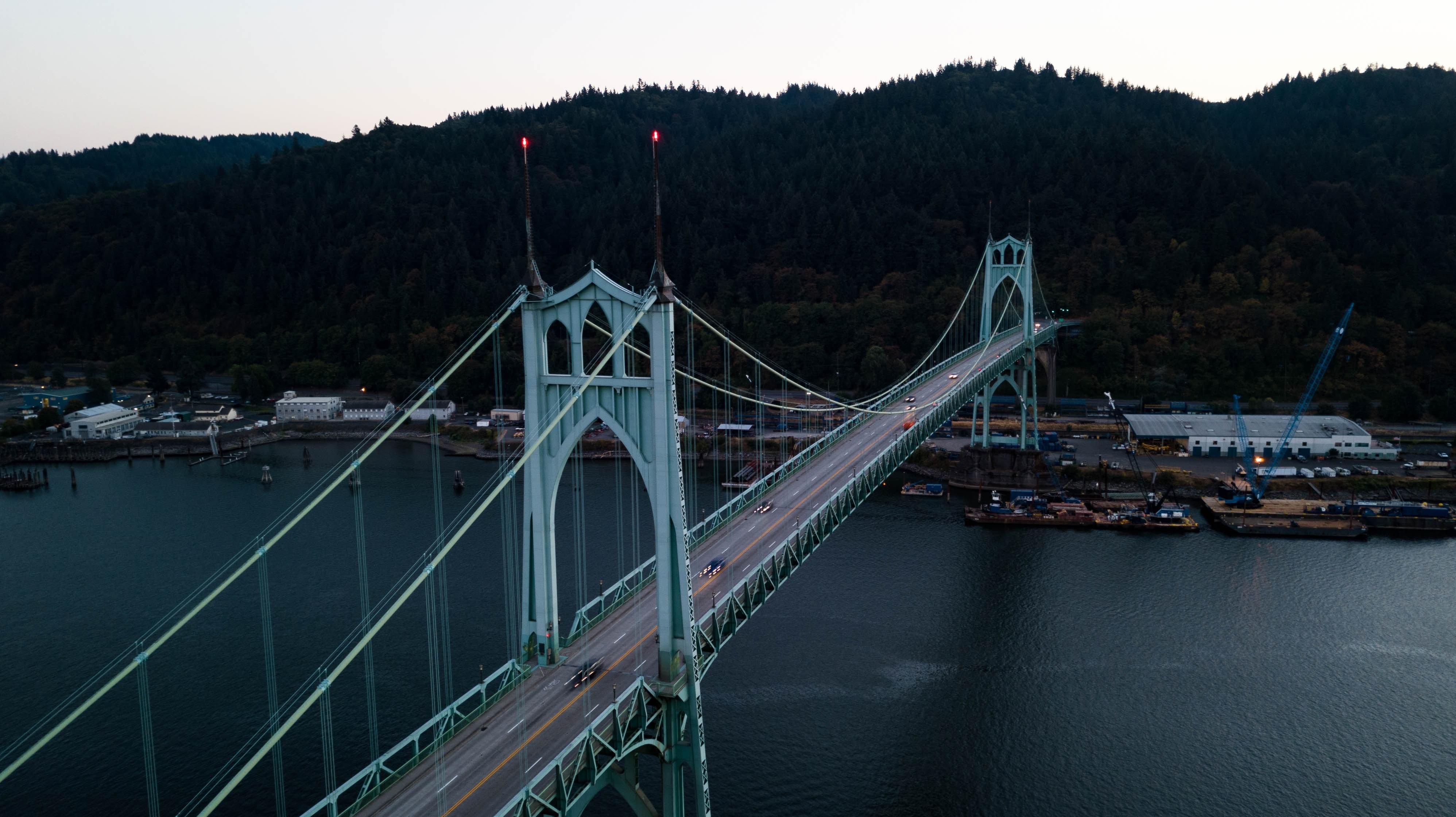 rope bridge above body of water