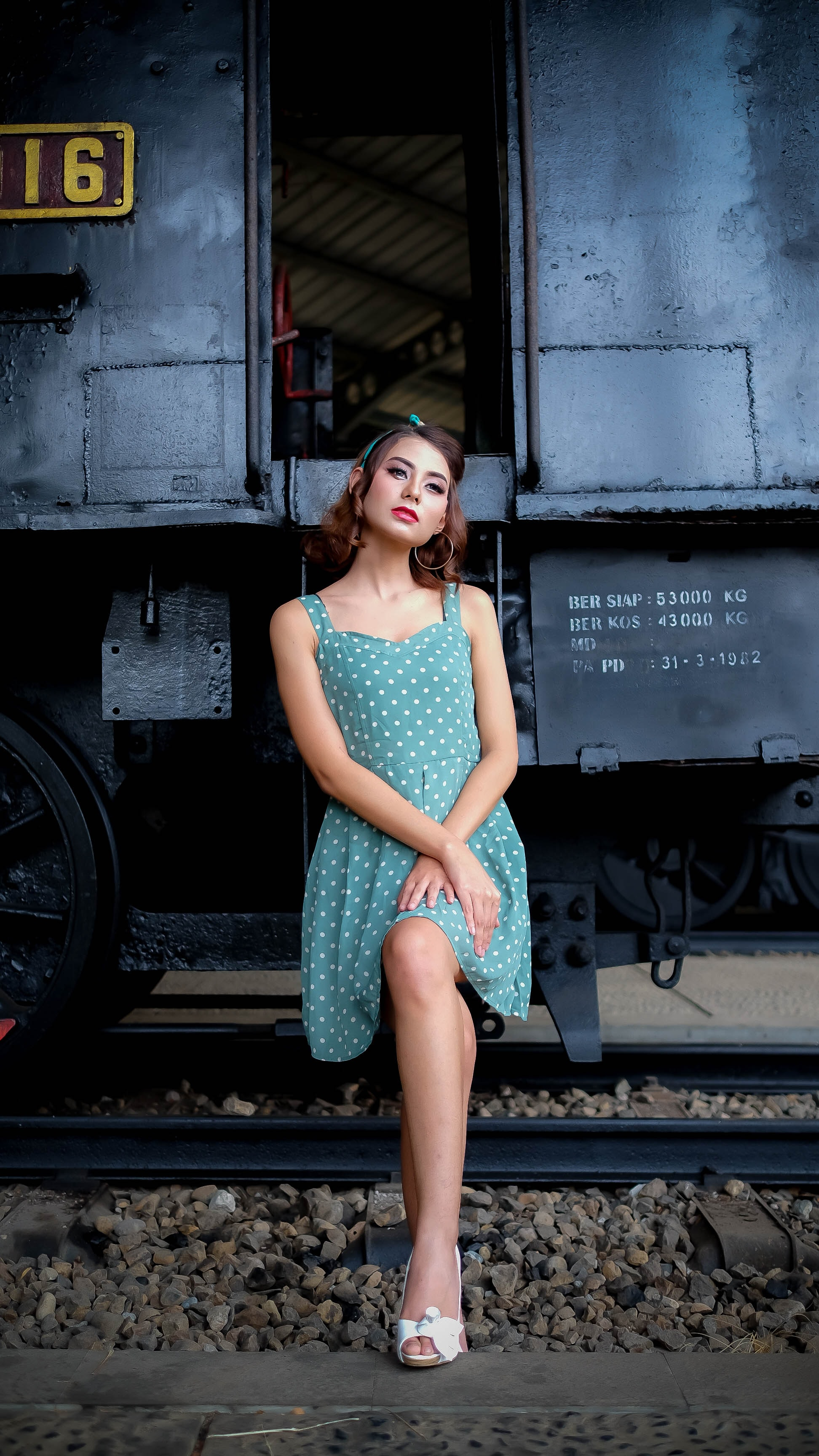 woman sitting on train posing for photoshoot