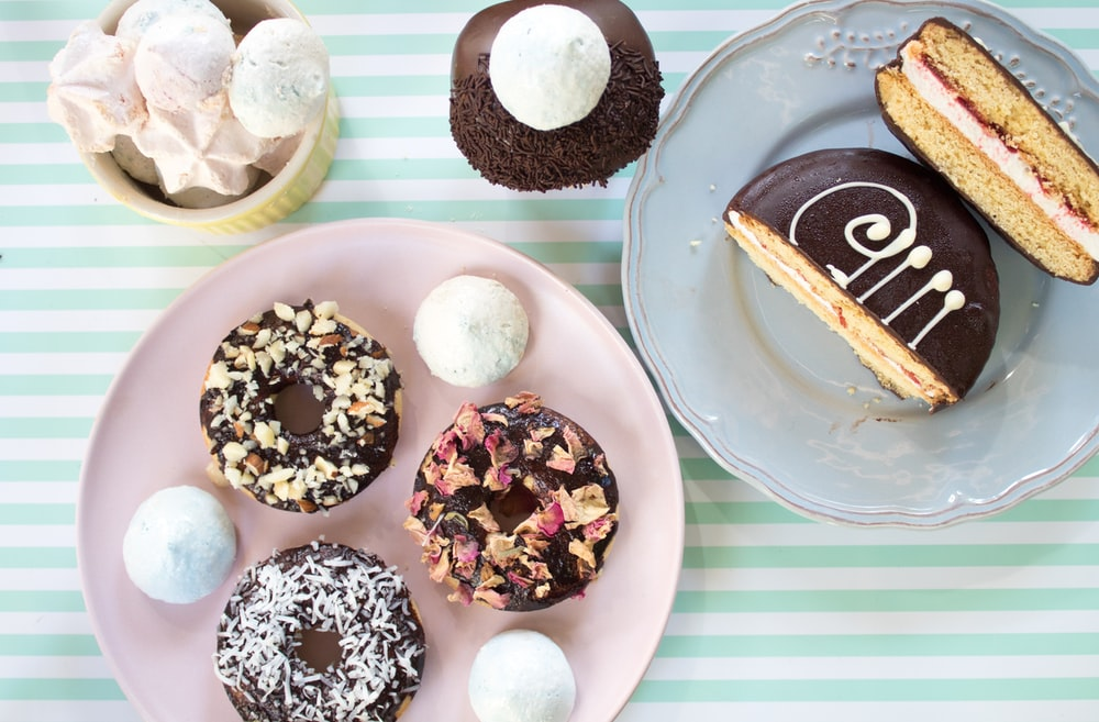 flat lay photography of doughnut on plate