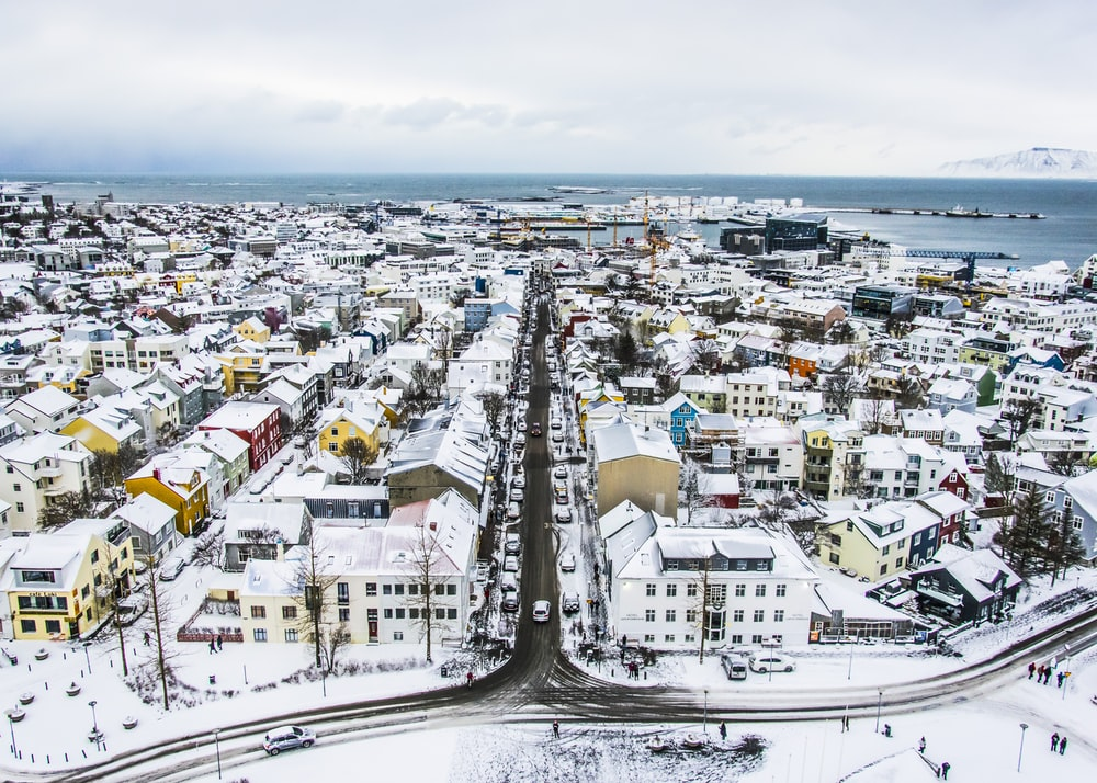 aerial photography of city surrounded with snow
