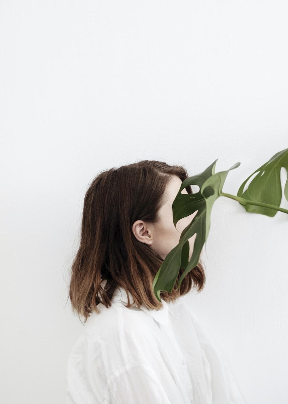 woman beside green leaf