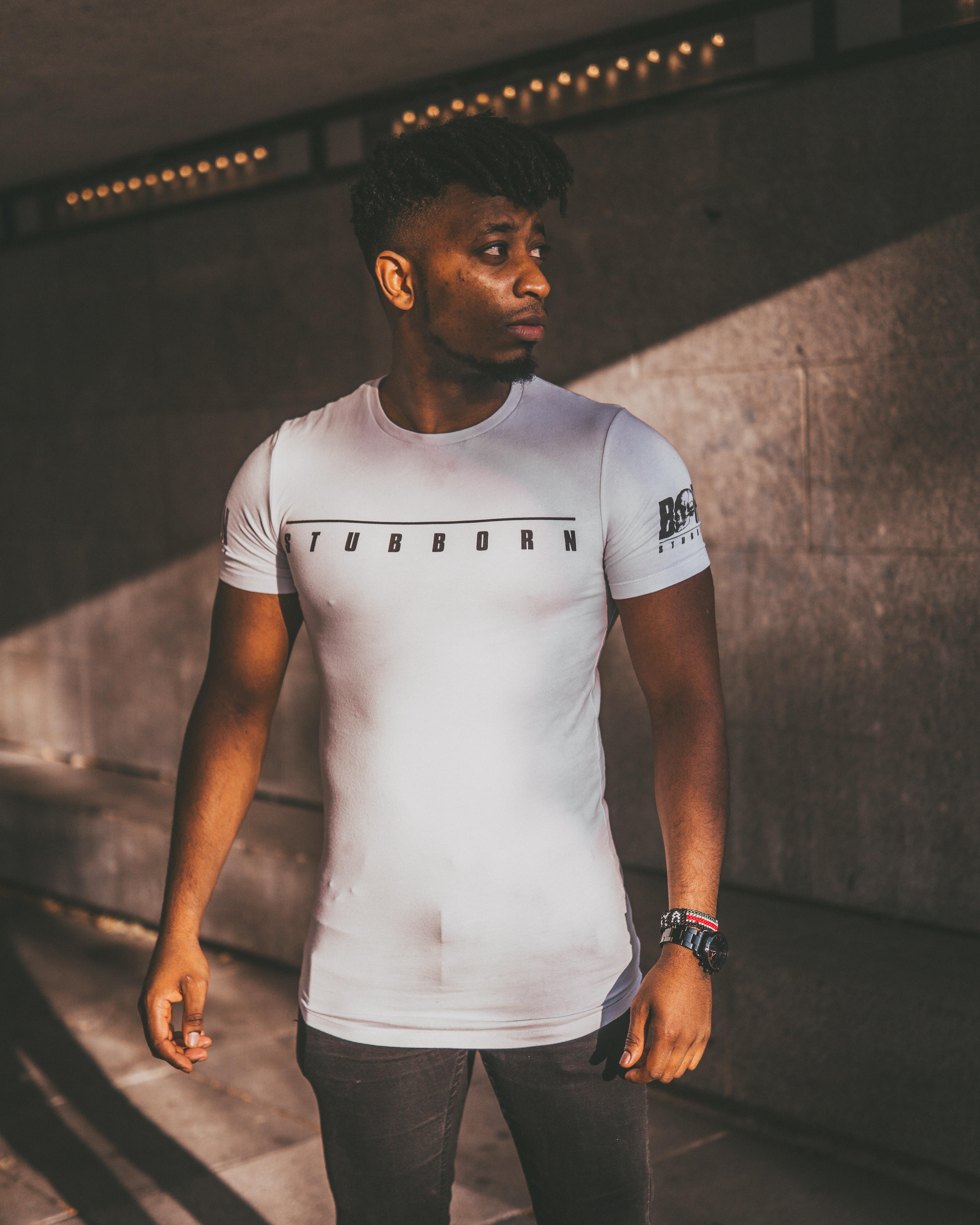standing man wearing white shirt