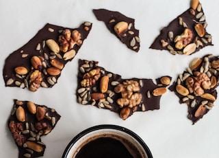 coffee on cup beside chocolates