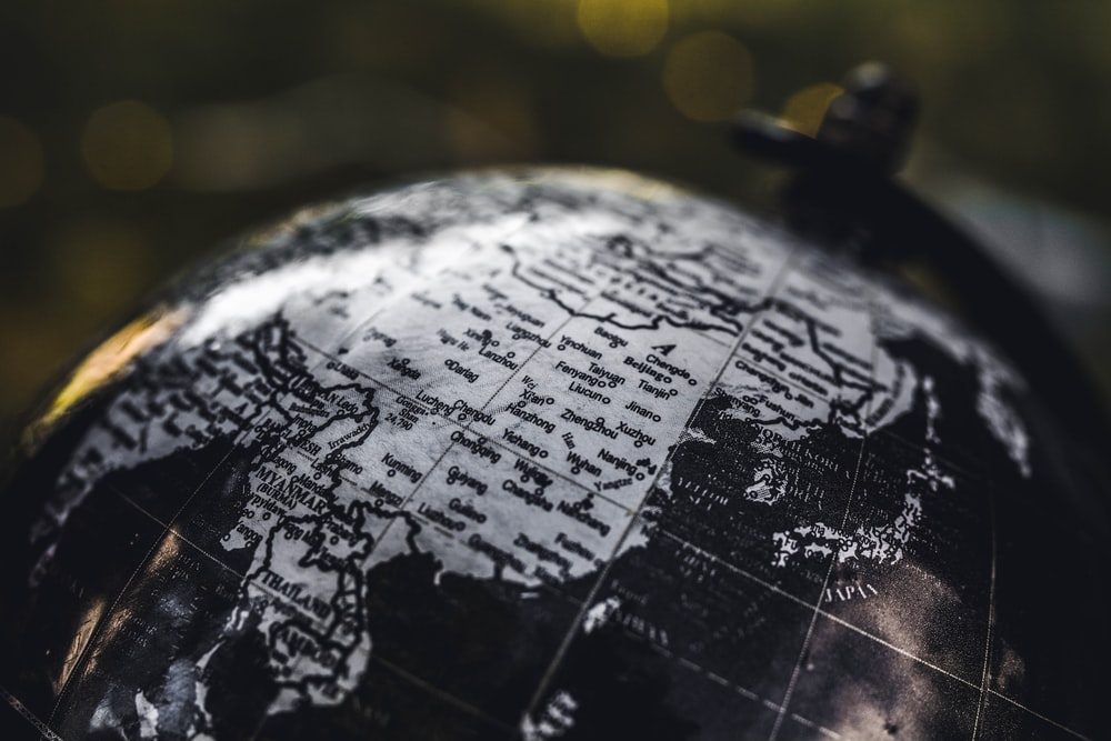 selective focus photography of desk globe