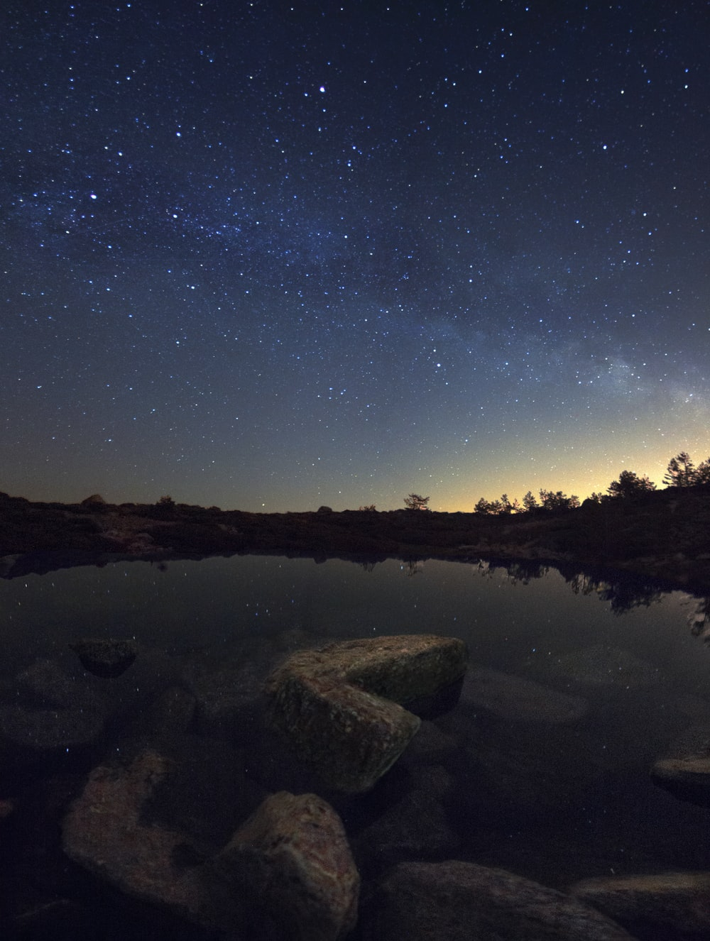 body of water and stone at nighttime photo