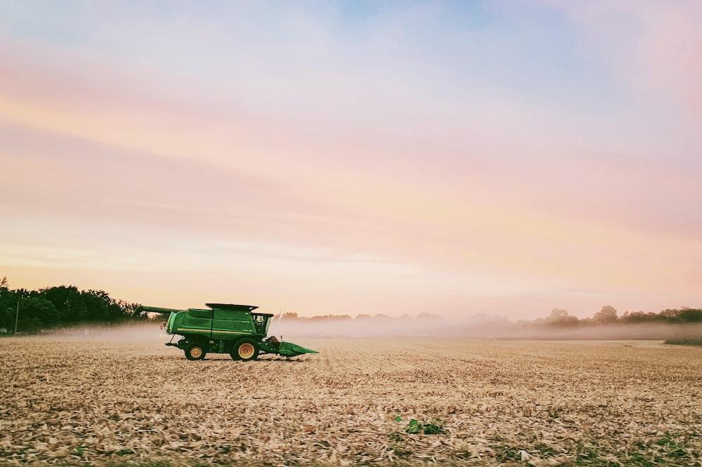 green farm truck on field