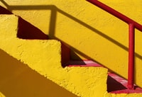 I went to Ayia Napa, Cyprus two summers ago. The hotel I stayed in was placed along the beach, and one could easily take a stroll along the coast which were connected to other beaches. I came along this bright yellow lifeguard tower, and it immediately caught my eye! With its red steps and railings I could not resist to move closer-a full frame shot is what I wanted - and got!
