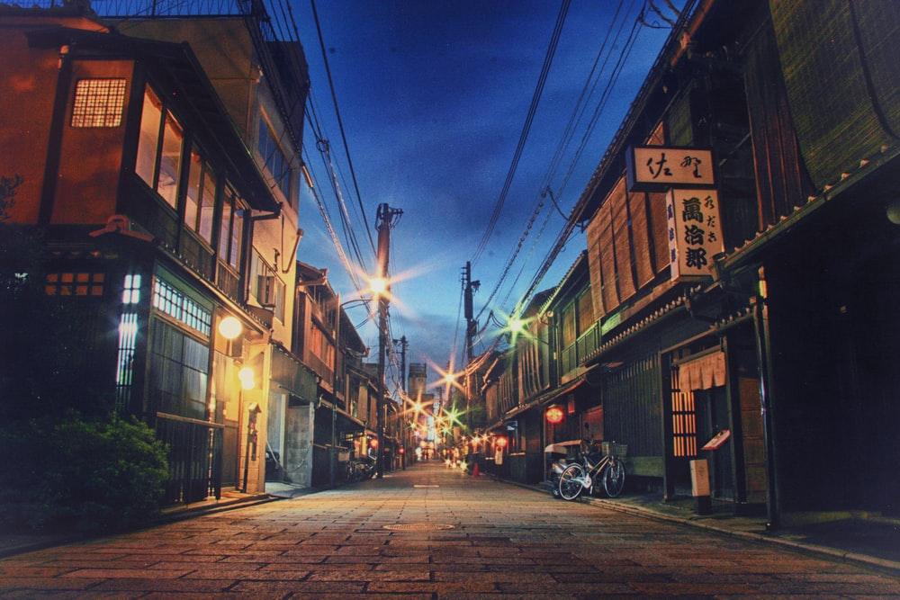 roadway between buildings at nighttime