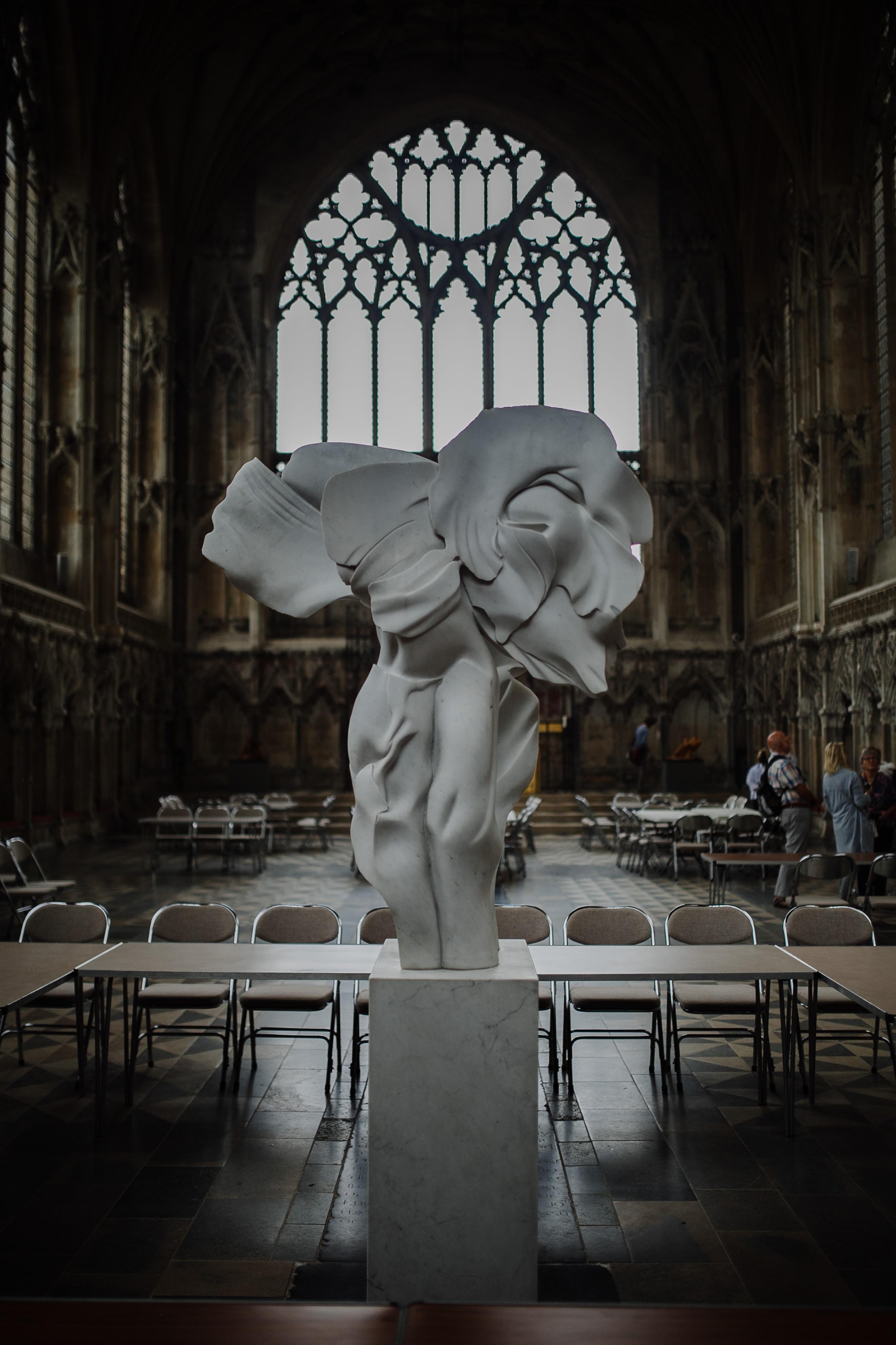 white concrete statue in room