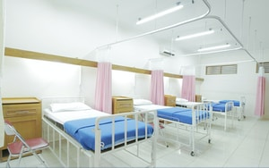 empty hospital bed inside room