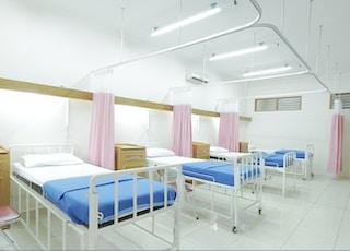 empty hospital bed inside room