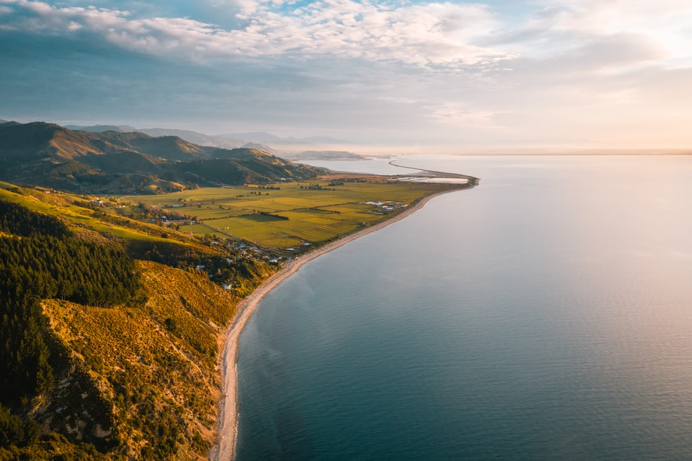 bird's-eye view photography of land and ocean