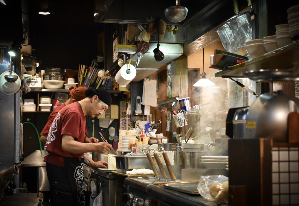man cooking inside kitchen