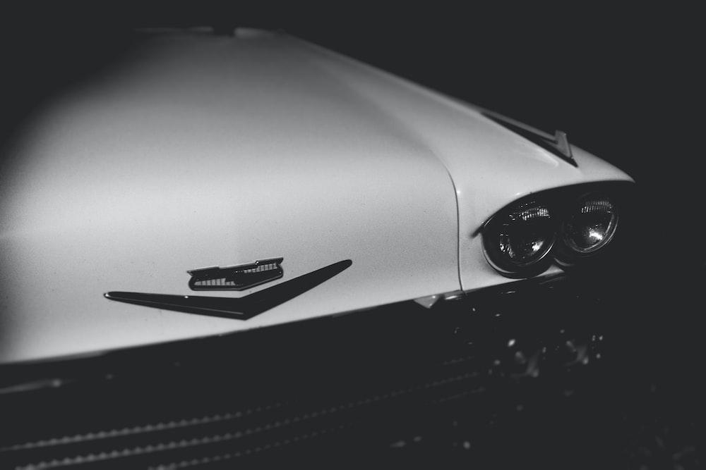 white classic vehicle hood