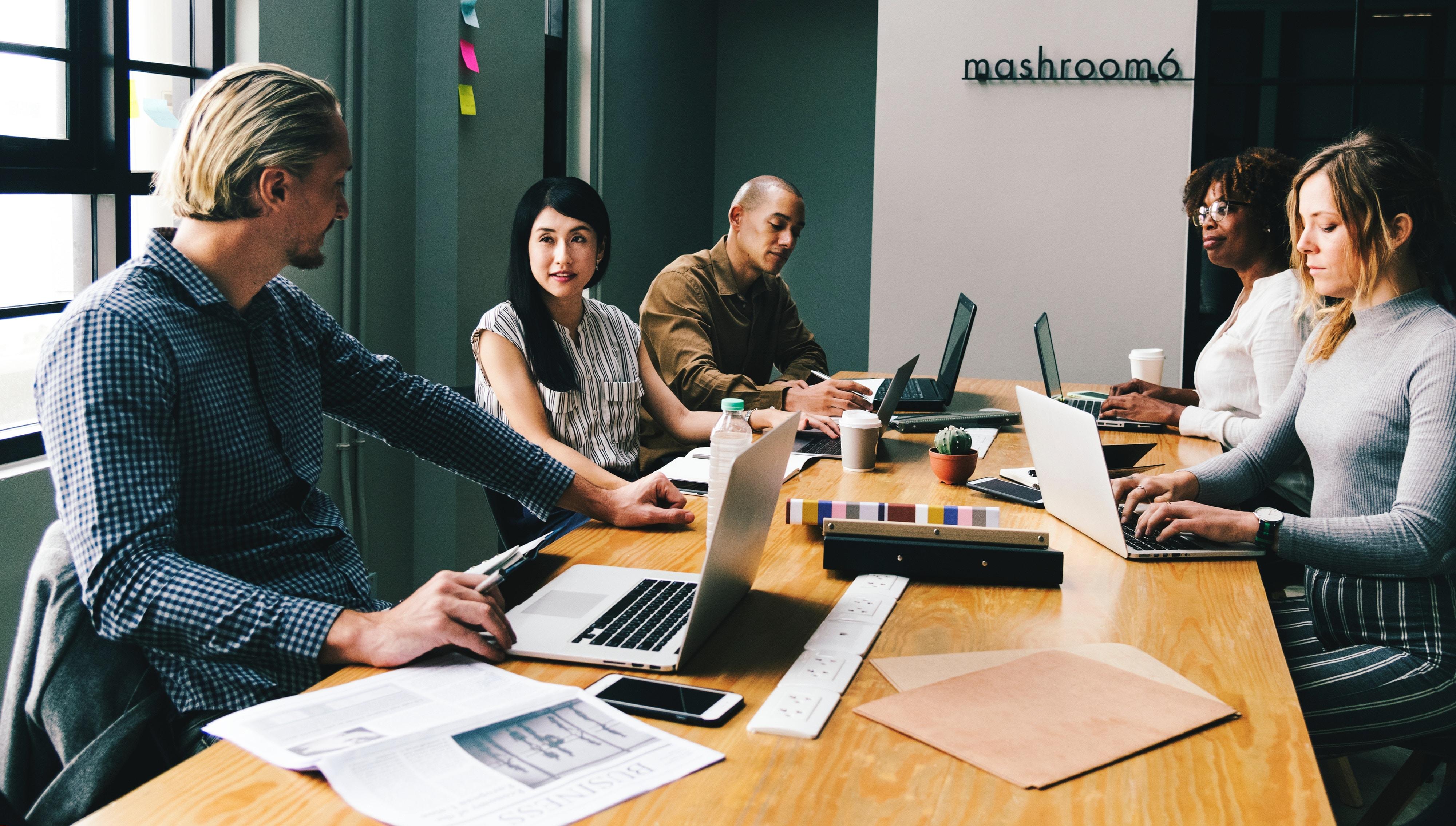people working on desk