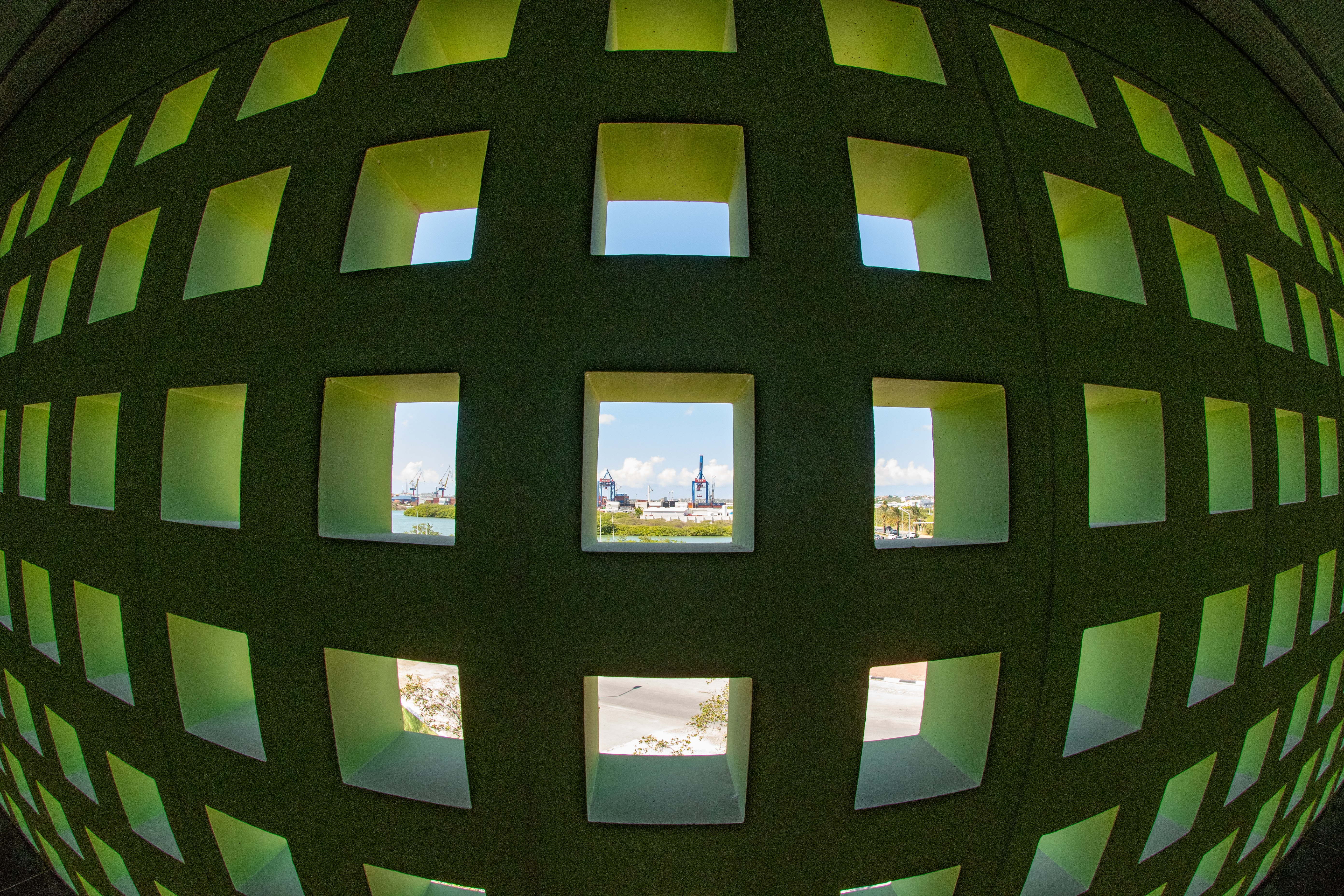 fish-eye photography of black and green grille