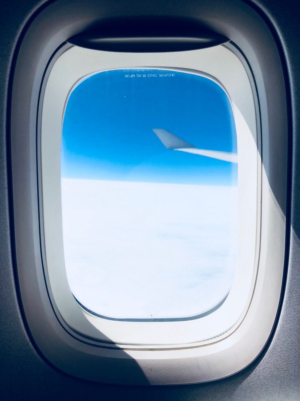close-up photo of airplane window