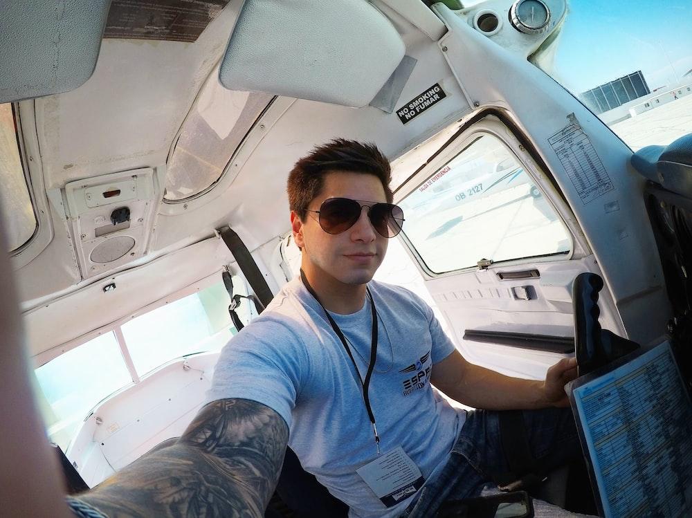 man taking selfie inside van