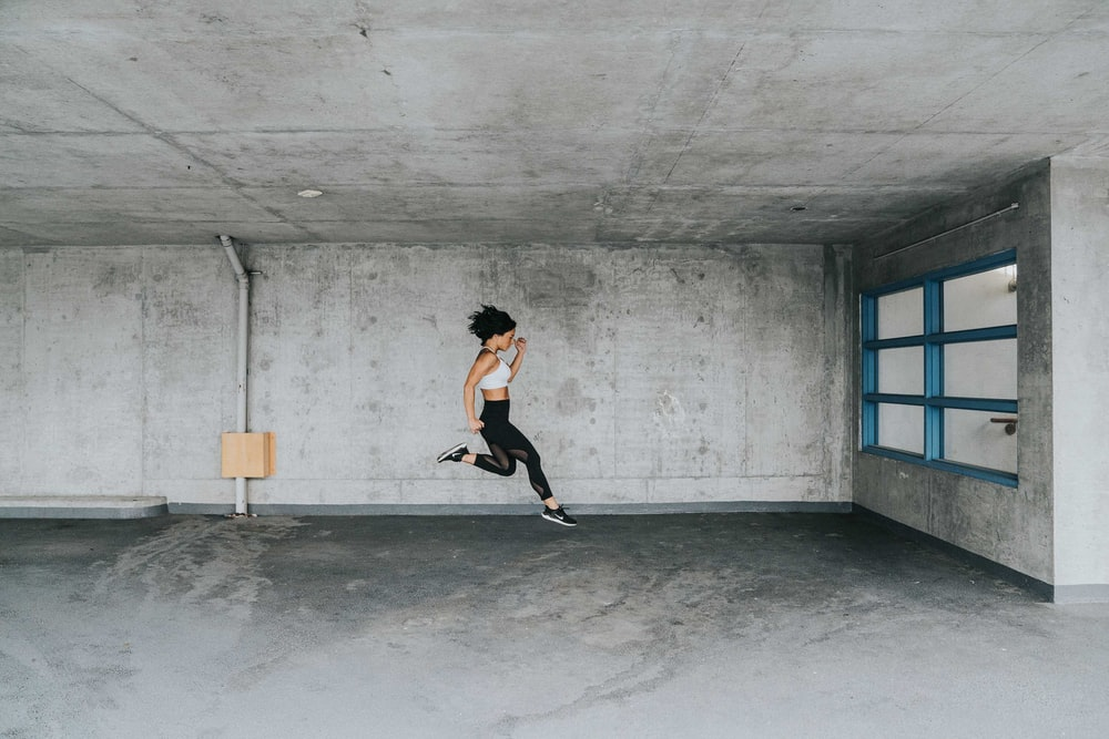 jumping woman inside building