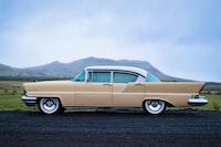 vintage beige sedan on the road