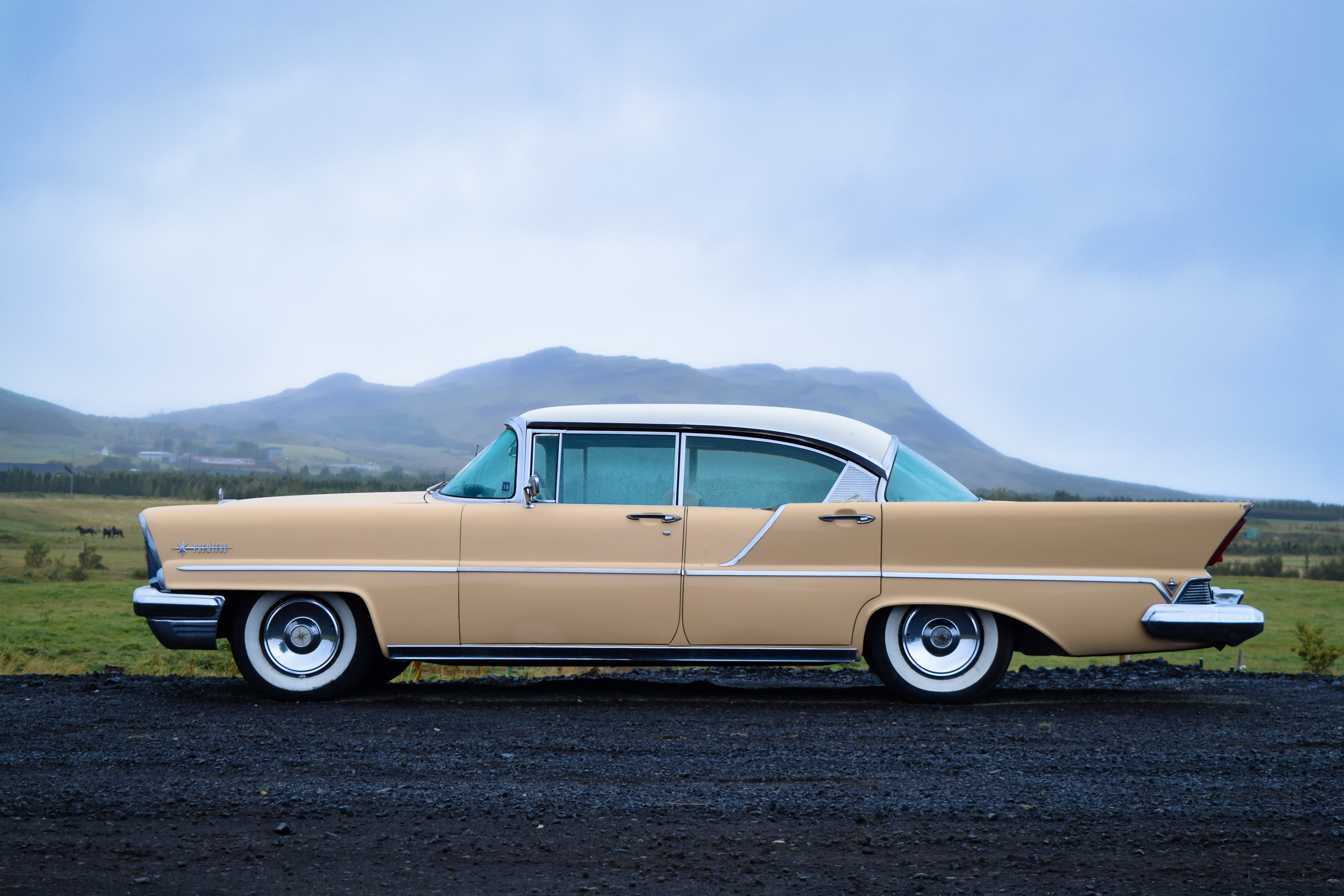 vintage beige sedan on the road