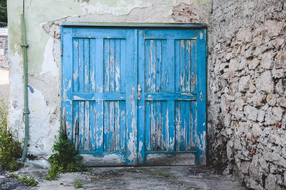 blue wooden panel doors closed