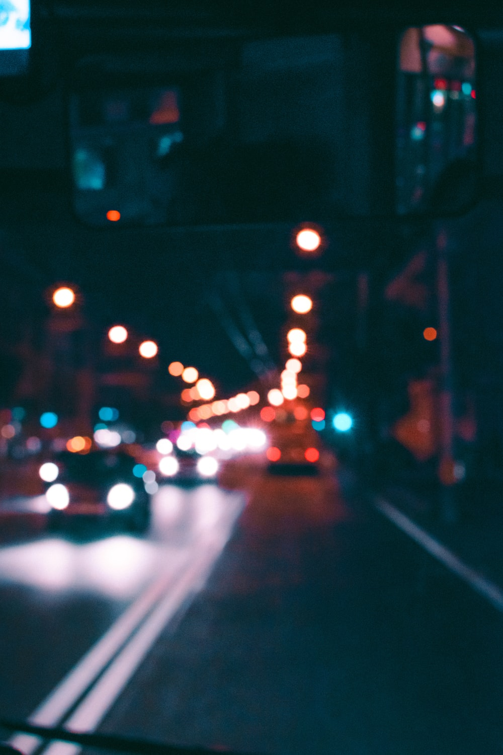 bokeh photography of vehicles on street at night