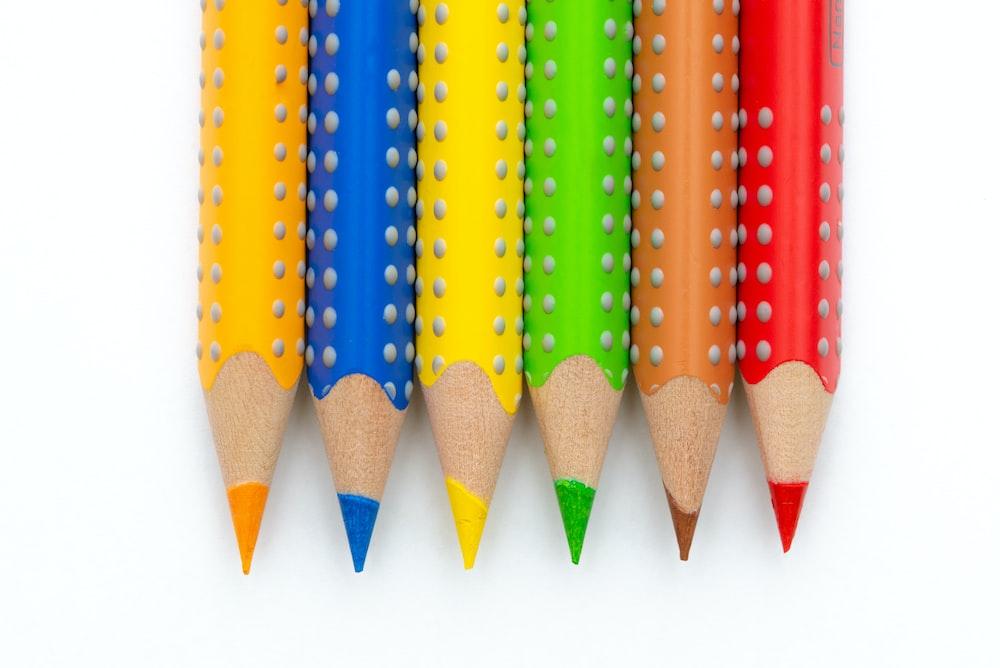 six assorted-color colored pencils closeup photo