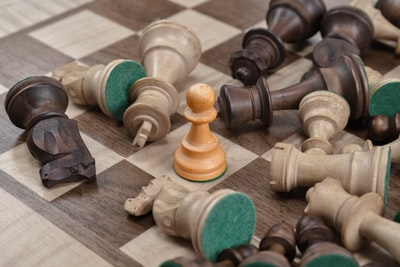 closeup photo of gray and brown chess board set