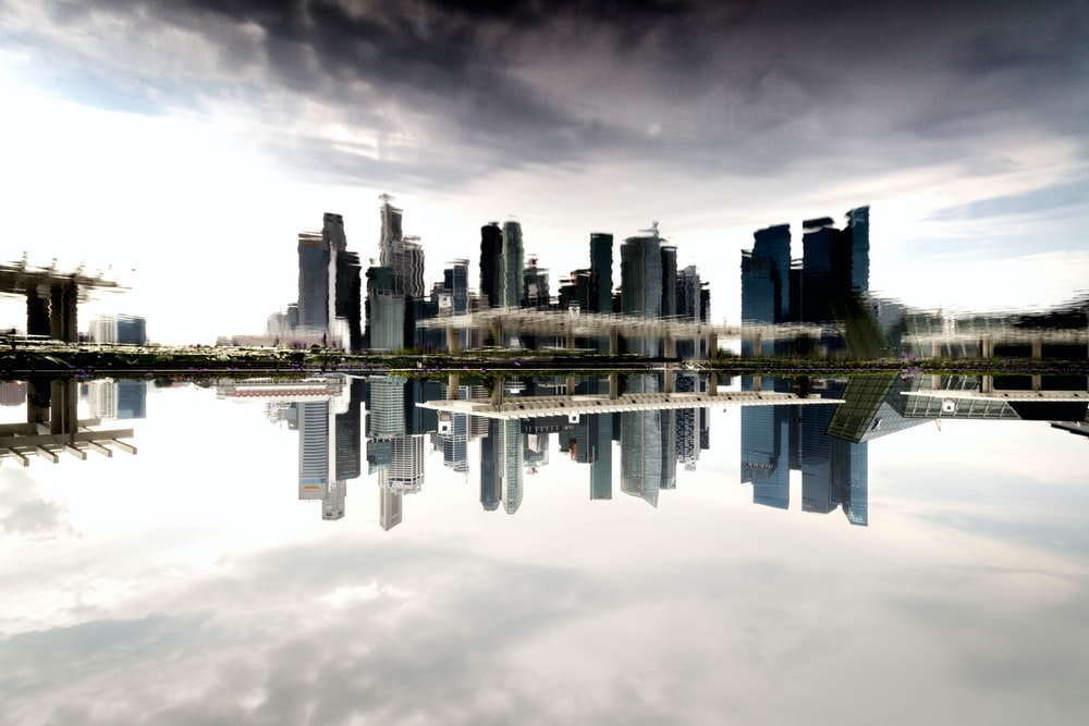 landscape photography of high-rise building near body of water