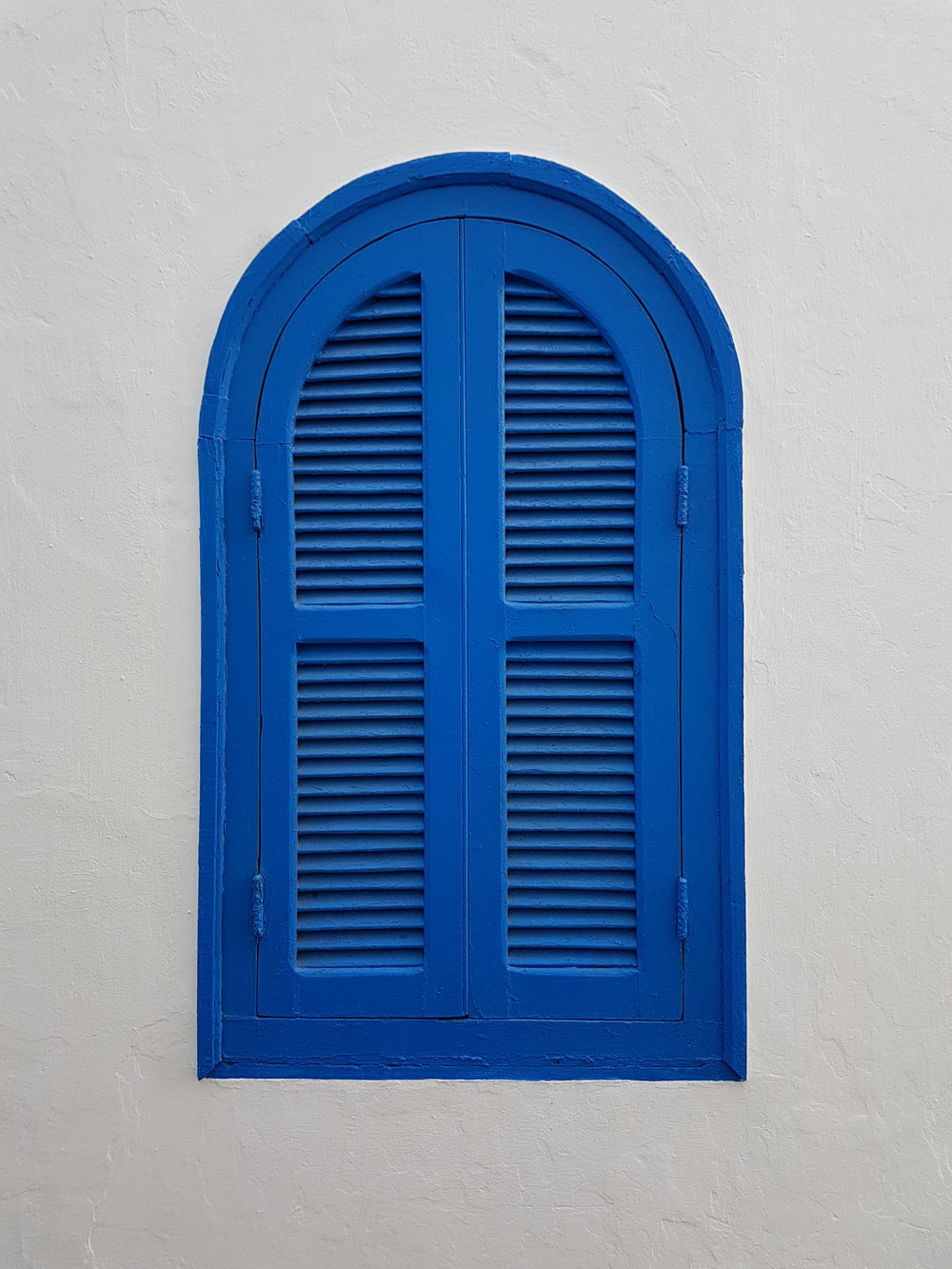 blue wooden window on wall