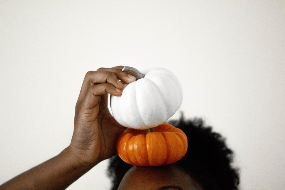 two white-and-orange pumpkins