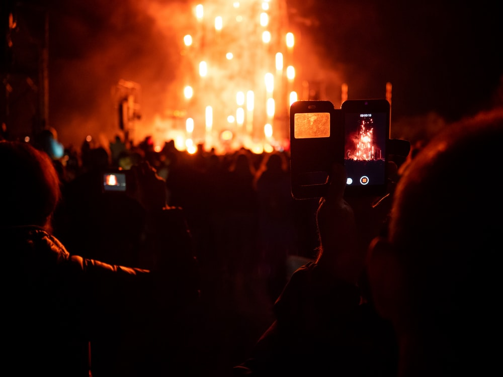 person taking picture of fireworks