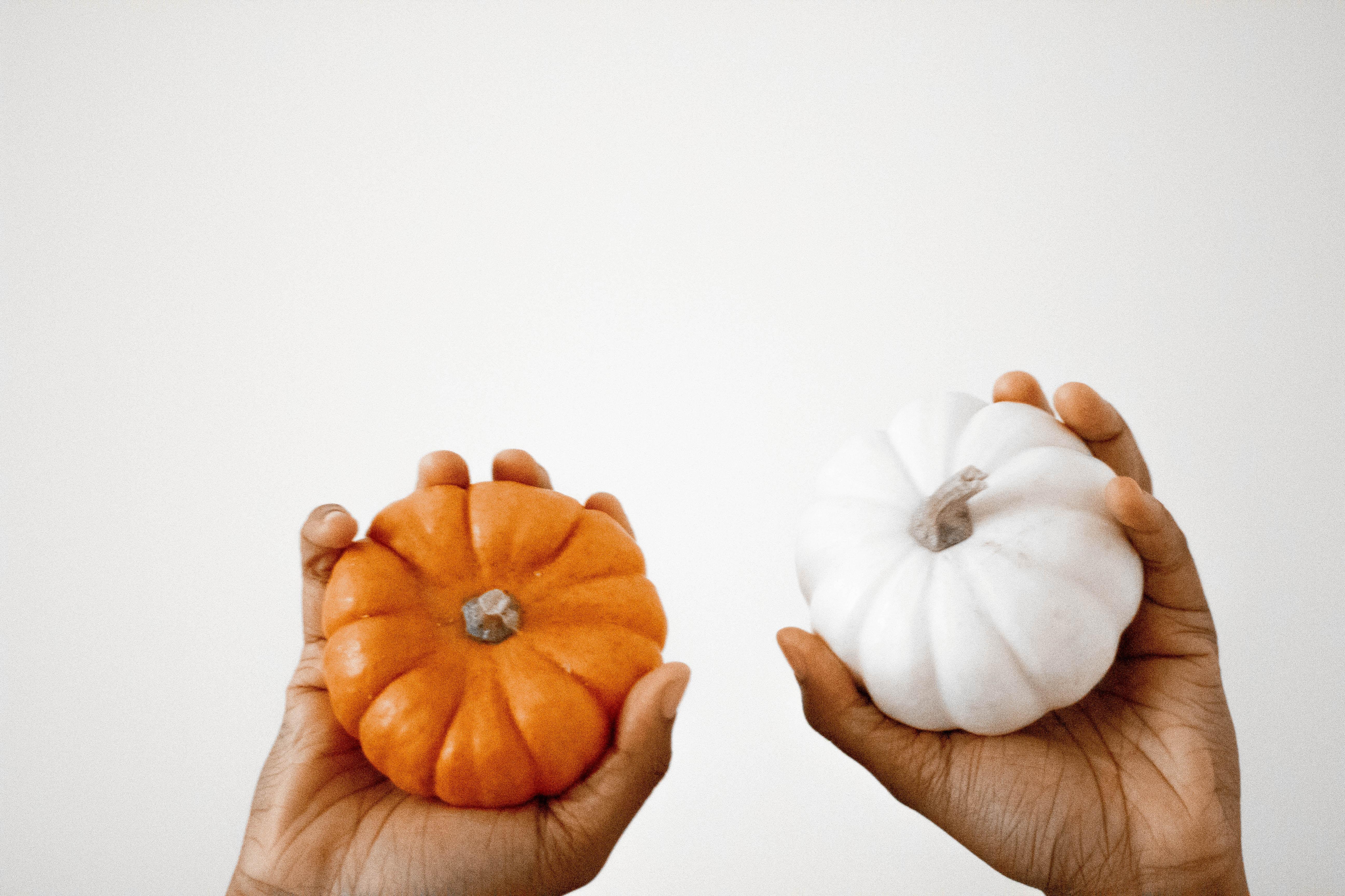 two orange and white pumpkins