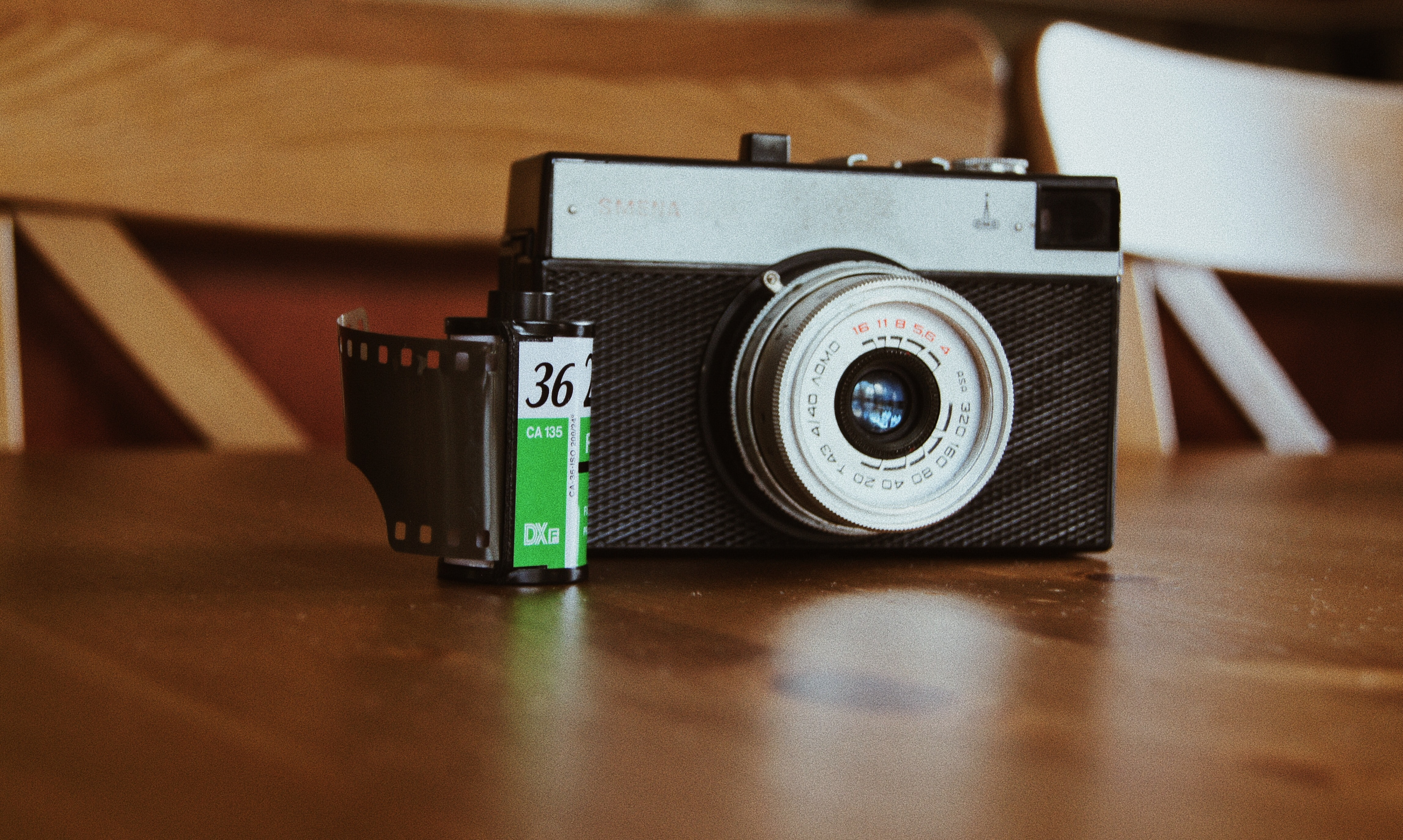 black and gray film camera on brown surface