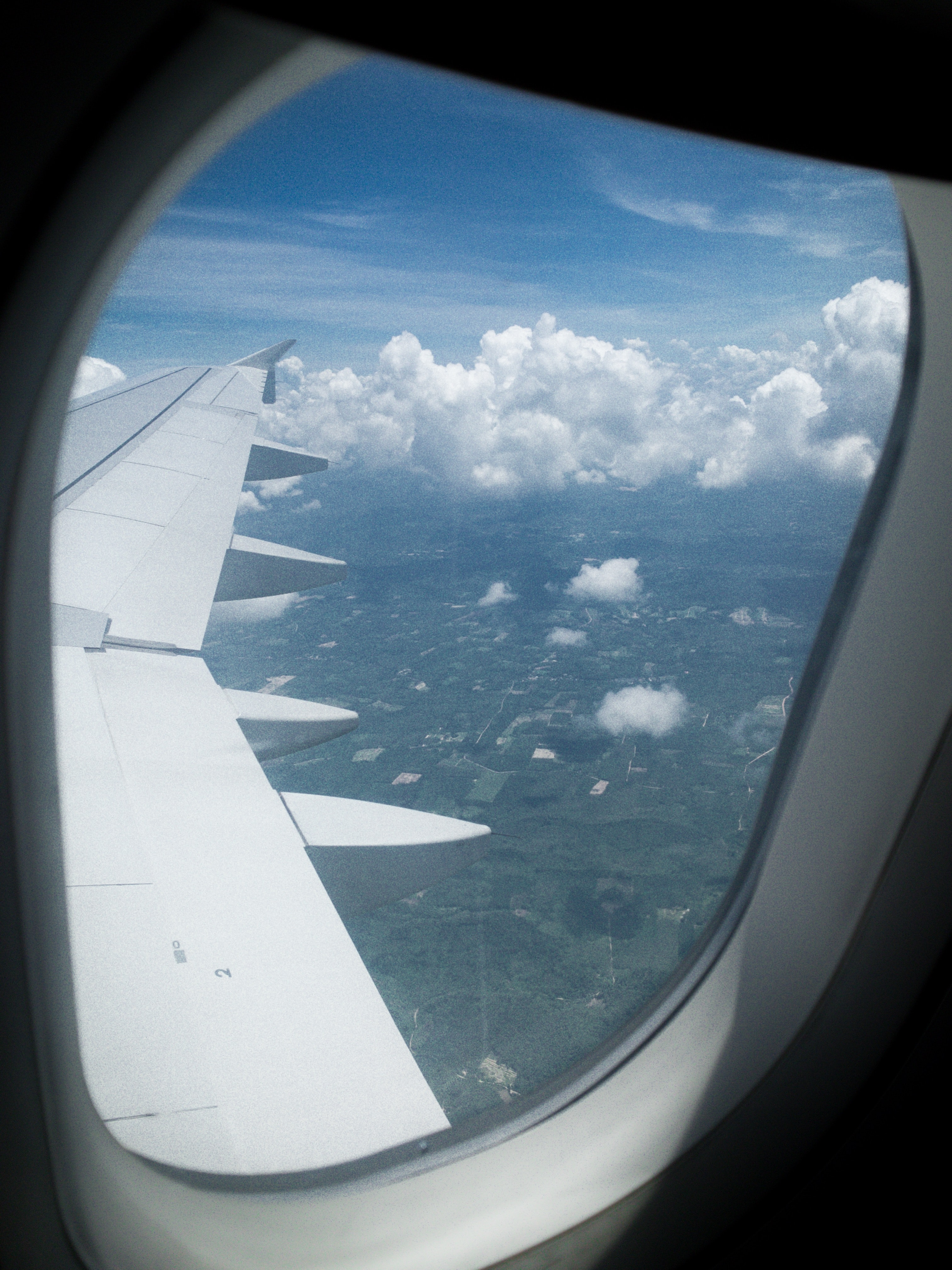 photo of airplane wing in flight