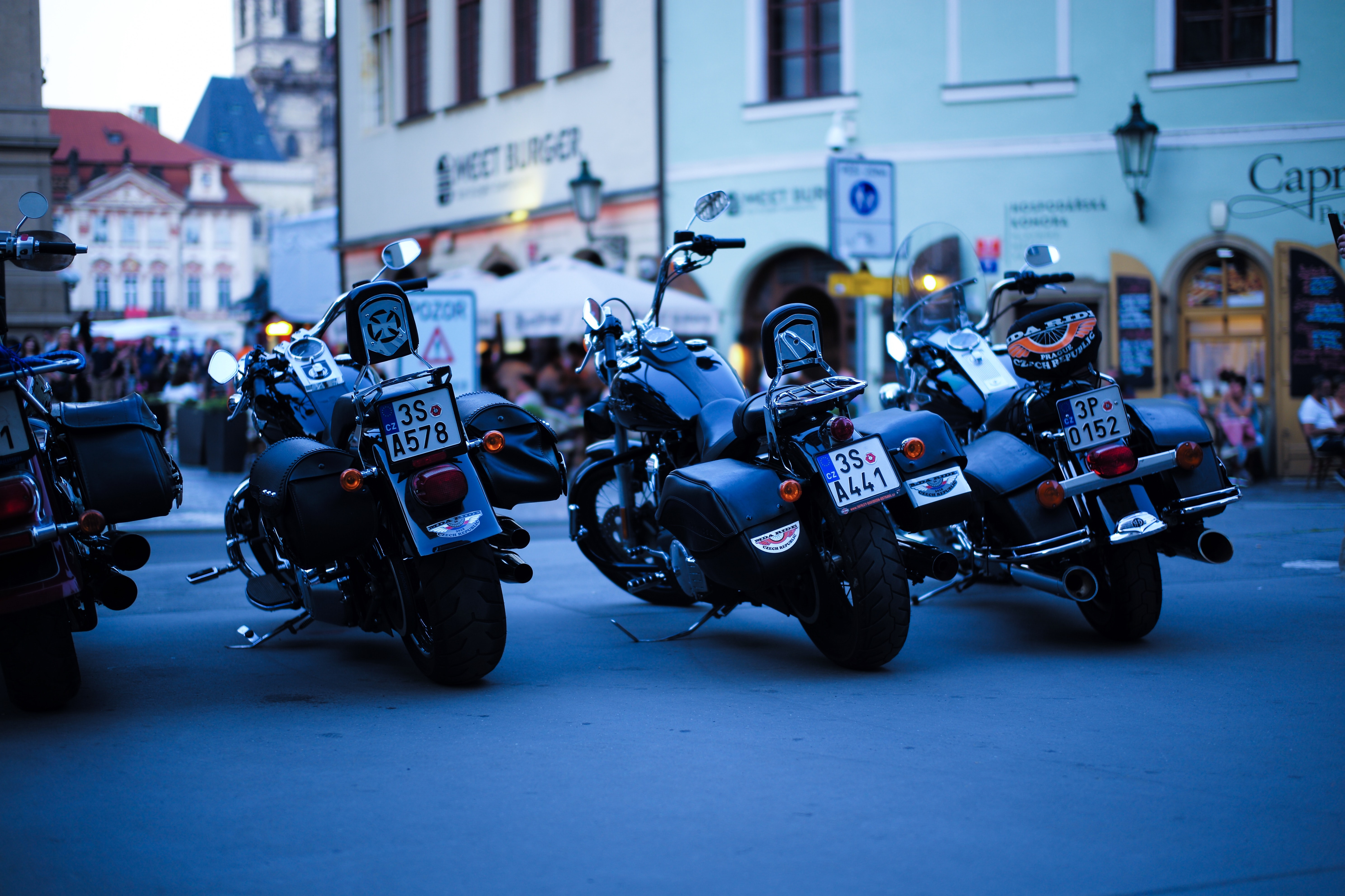 three parked motorcycles