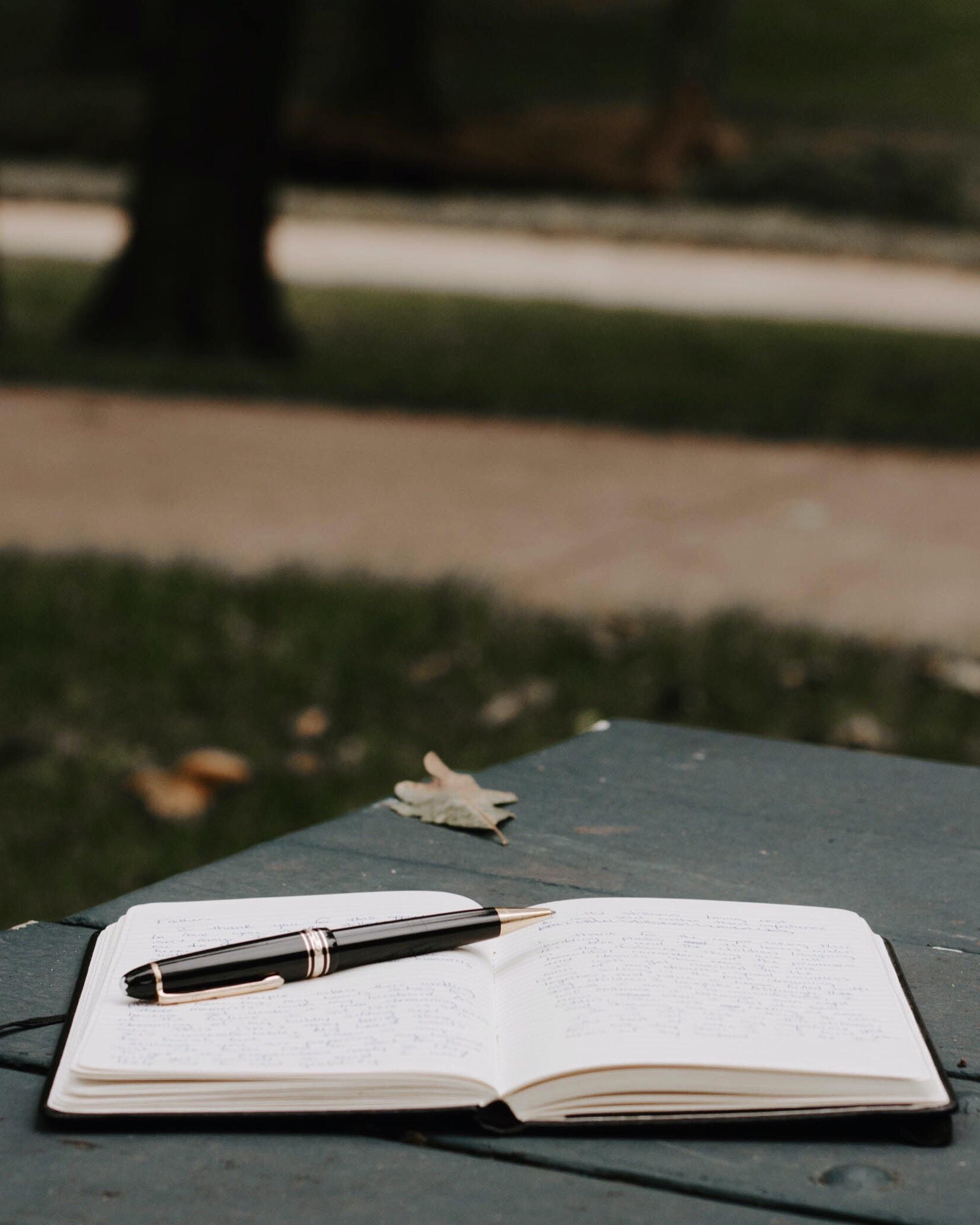black twist pen and planner