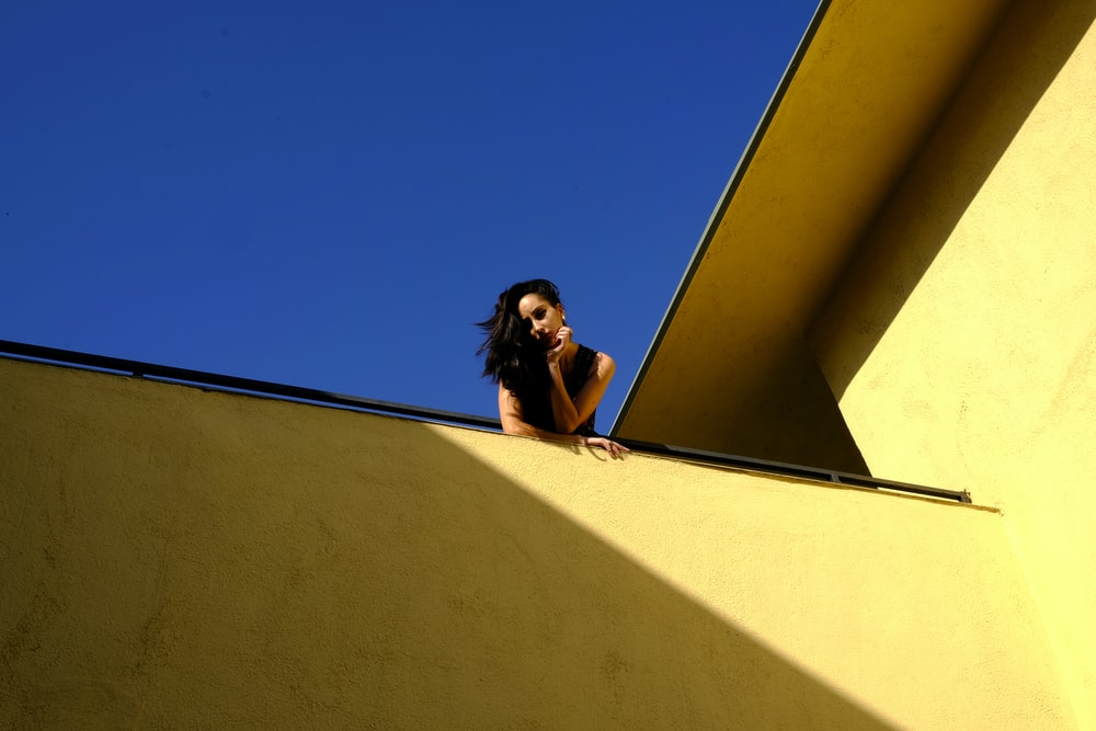 woman standing on rooftop during daytime