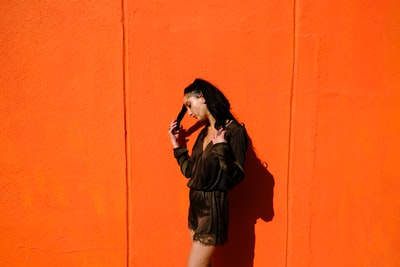 woman near orange wall