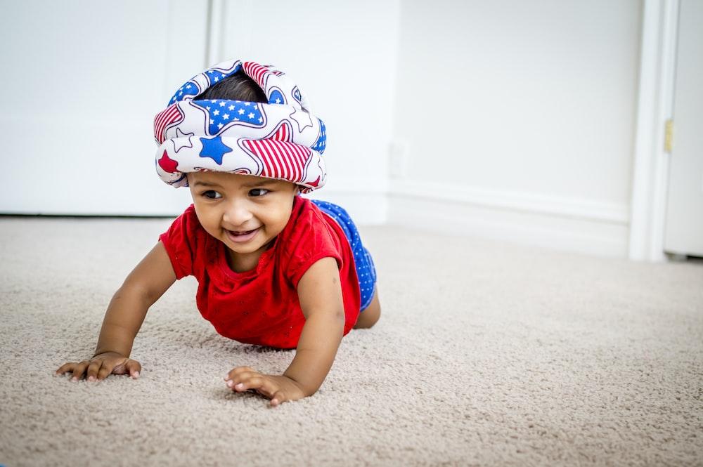 toddler crawling on area rug