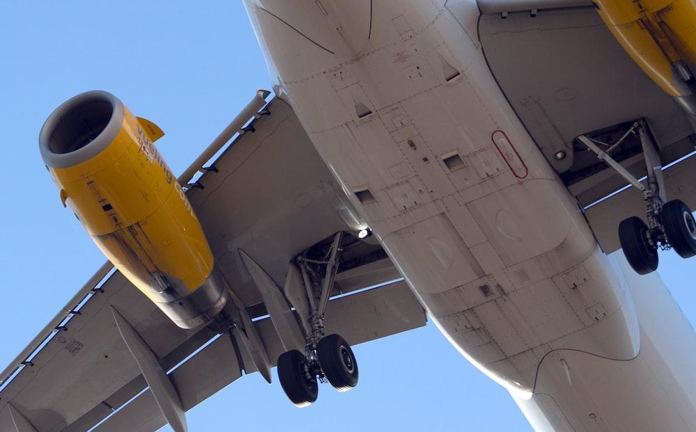 gray flying airplane during daytime