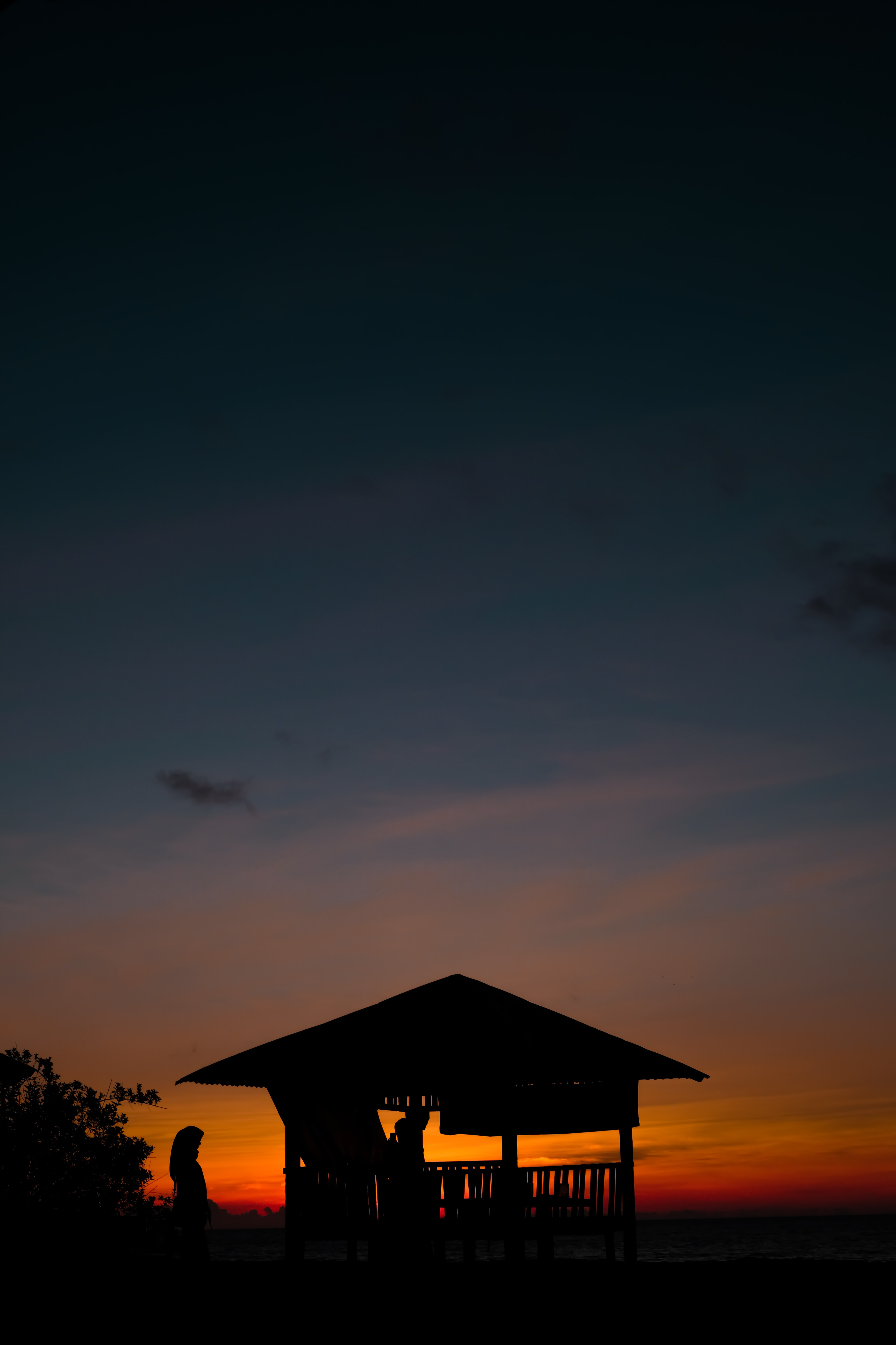 silhouette of gazebo during sunset
