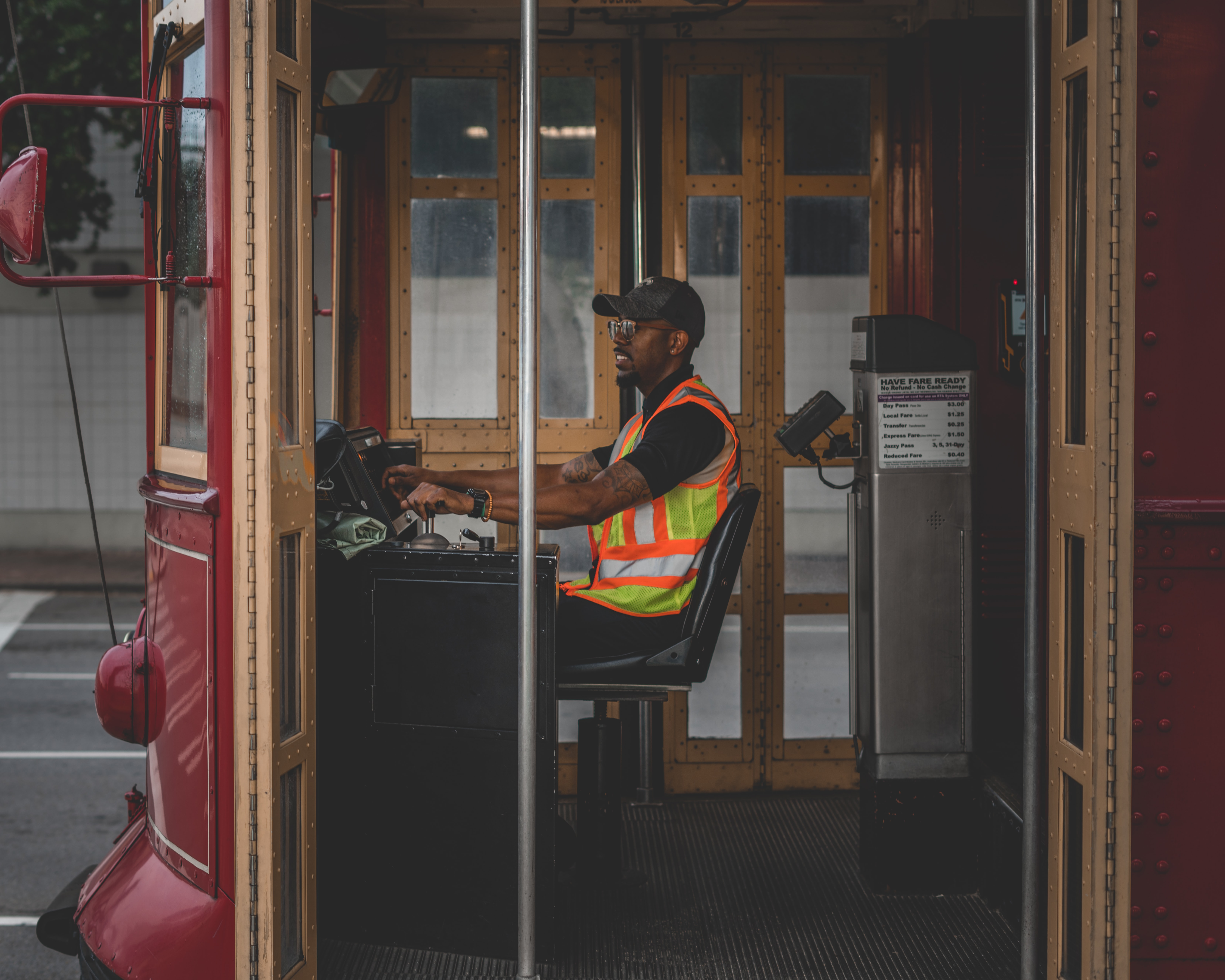 man sitting on chair controlling bus