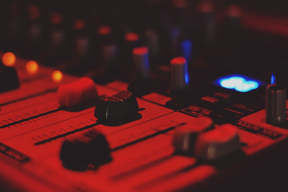 close-up photo of audio mixer with red dim light