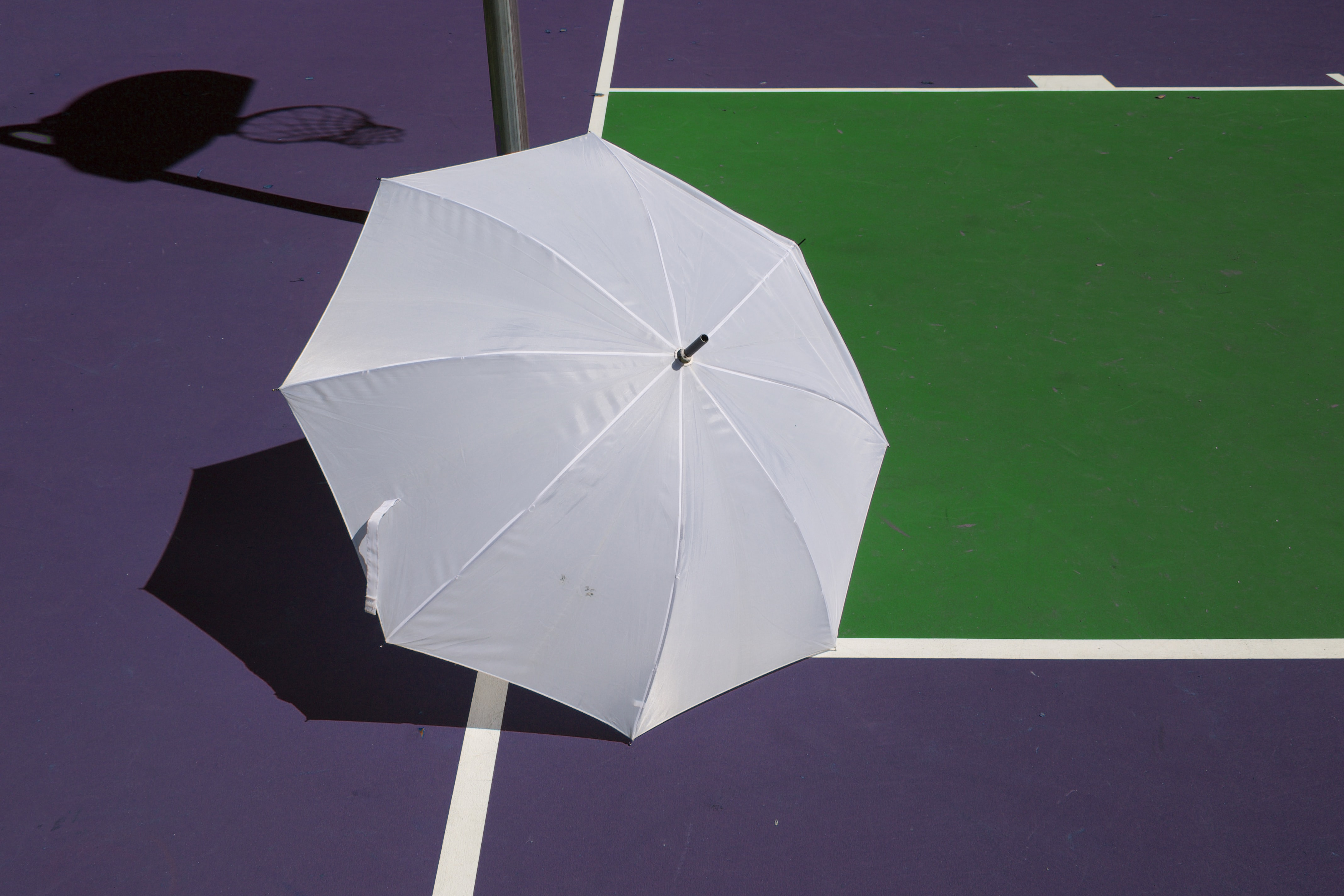 white umbrella purple surface