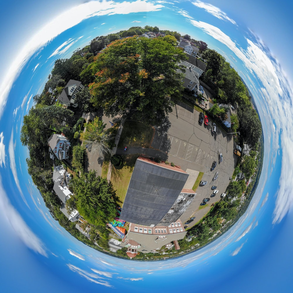 aerial photo of building with parking lot in little planet photography